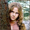 Hermione behind a tree